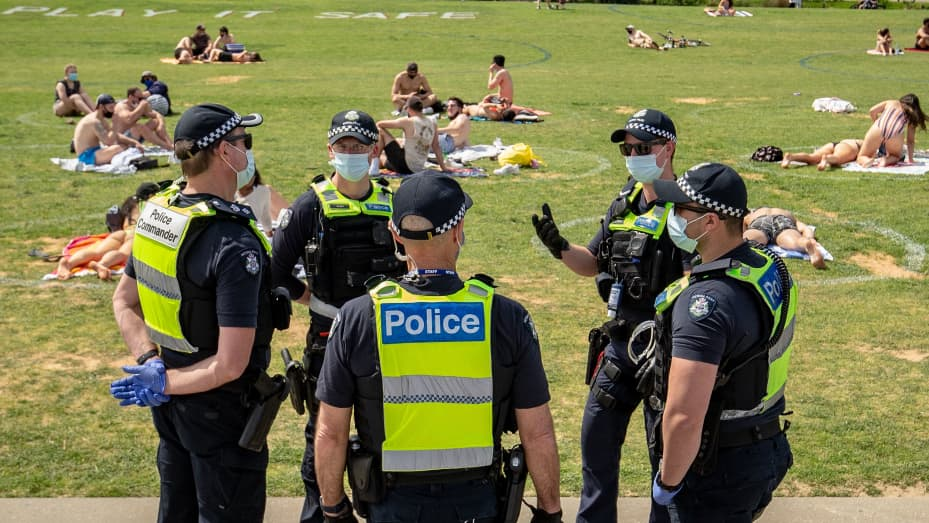 Victoria Police patrol at St Kilda beach on October 03, 2020 in Melbourne, Australia. Coronavirus restrictions eased slightly across Melbourne from Monday 28 September as Victoria enters into its second step in the government's roadmap to reopening.