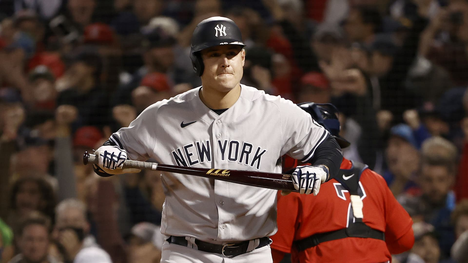 Anthony Rizzo #48 of the New York Yankees reacts after striking out against the Boston Red Sox eighth inning of the American League Wild Card game at Fenway Park on October 05, 2021 in Boston, Massachusetts.