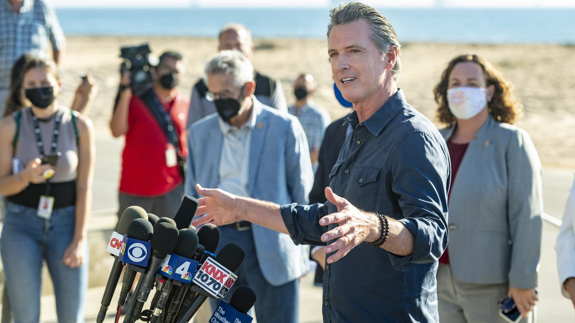 Surrounded by local, state and national officials, California Governor Gavin Newsom speaks during a news conference at Bolsa Chica State Beach in Huntington Beach, site of the the recent offshore oil spill, on Tuesday, October 5, 2021. waters.