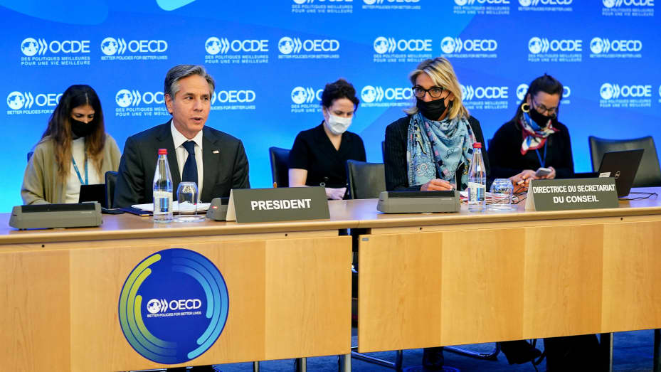 US Secretary of State Antony Blinken (frontL) speaks past OECD Director of Council and Executive Committee Secretariat (SGE/CES) Silvia da Rin Pagnetto (frontR) during a closing session at the Organisation for Economic Cooperation and Development's Minist