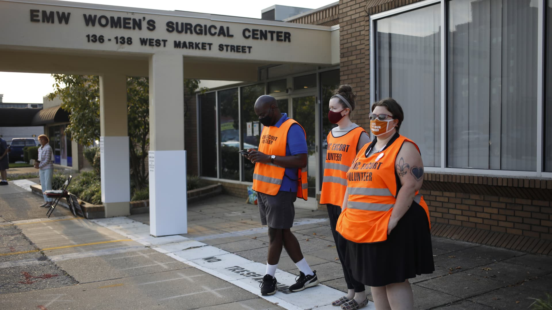 Volunteer clinic escorts wait for patients outside the EMW Women's Surgical Center in Louisville, Kentucky, U.S., on Tuesday, Sept. 28, 2021.