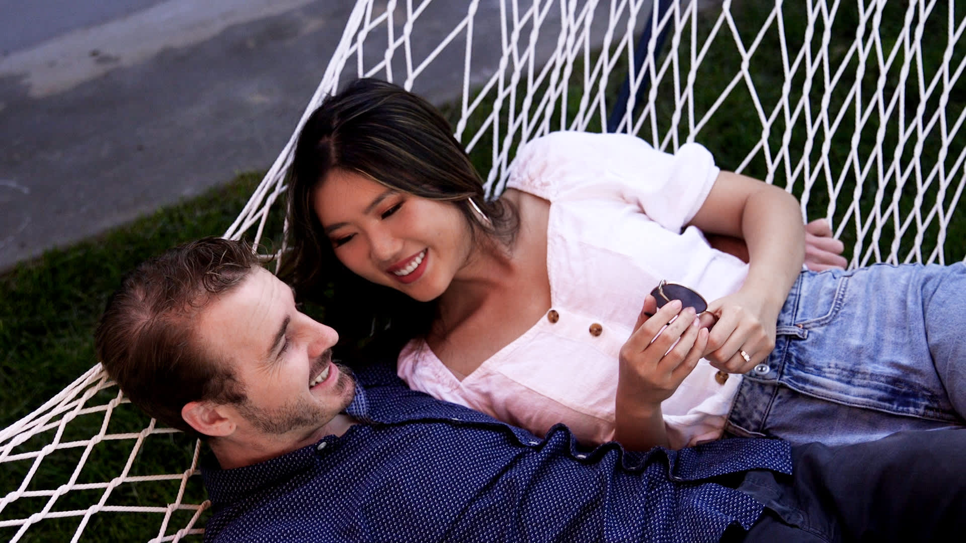 Kim Liao and her husband Greg Bollweg relax in their backyard.