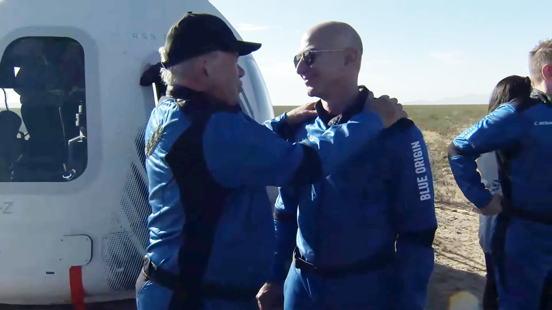 A screenshot taken from a live handout video on October 13, 2021 shows Jeff Bezos talks to William Shatner after Blue Origin's New Shepard crew capsule landed back in Texas, the United States.