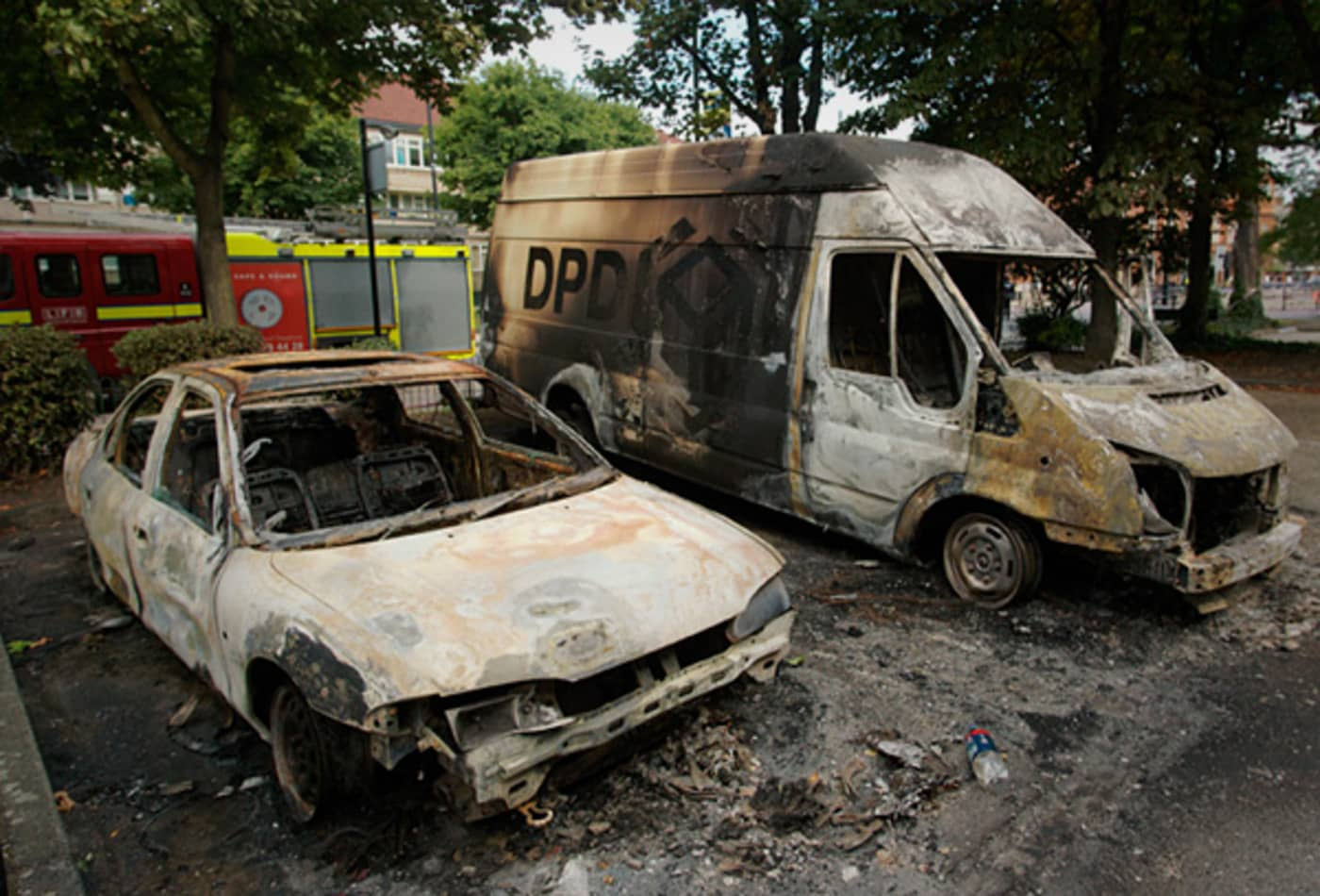 CNBC_scenes_from_london_riots_burnt_cars.jpg