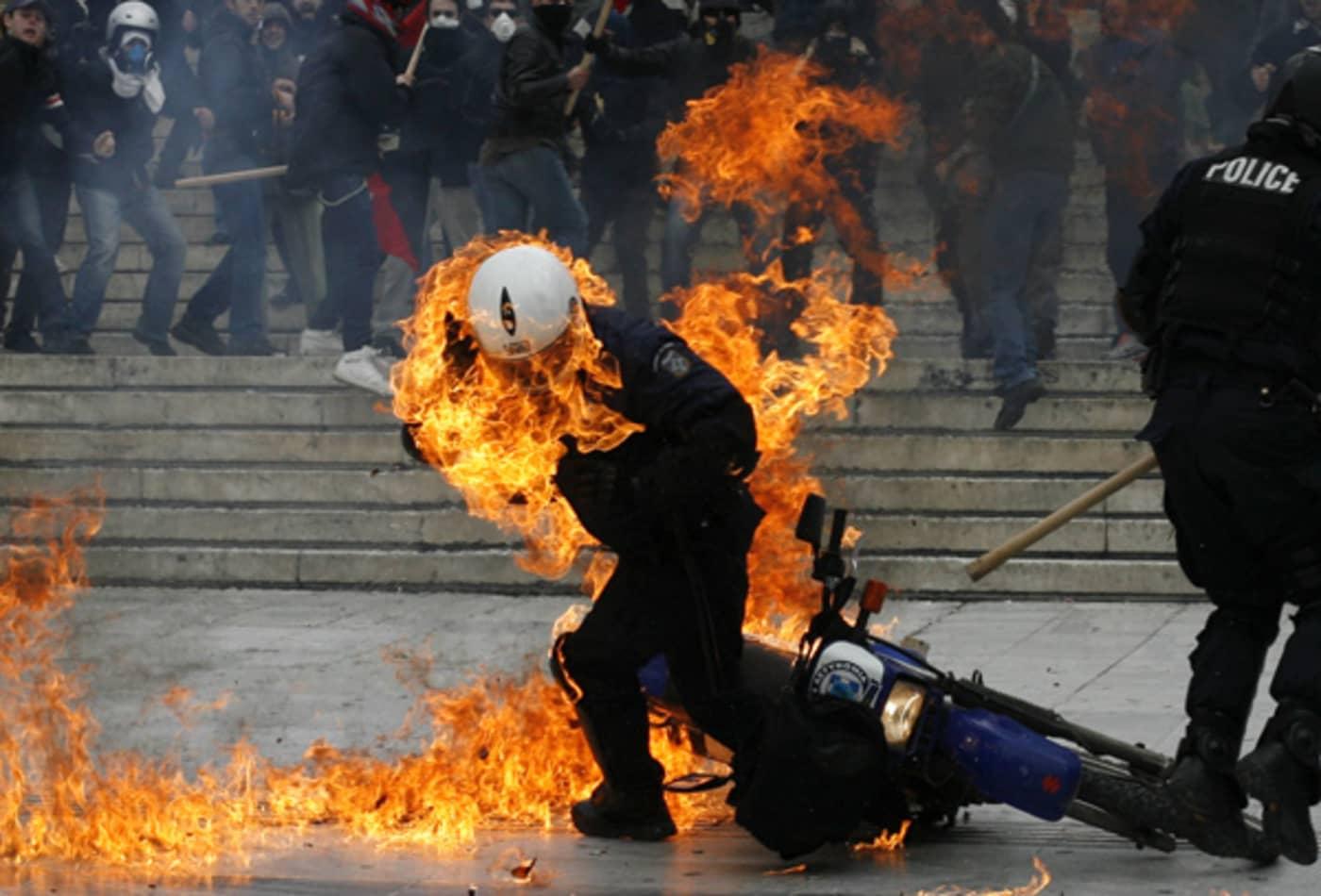 CNBC_Major_Events_Eurozone_Policeman_Burning.jpg