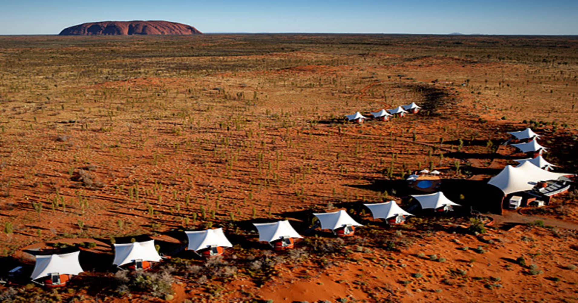 Double occupancy starts at $2,070 per room per night. If you stay three nights or more, the price drops to $1,758. A string of 15 tents dotting a sand dune in the Outback may not sound luxurious, but the tents of cover 430-square-feet and have air-conditioning, retracting blinds, and Bose sound systems.  Catch a direct flight to Ayers Rock Airport from Sydney to catch a 4WD vehicle for the last six miles through the Outback to the resort. Watching the sunrise over Uluru (a natural sandstone roc